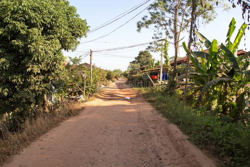 Camino en el campo de Laos foto de archivo