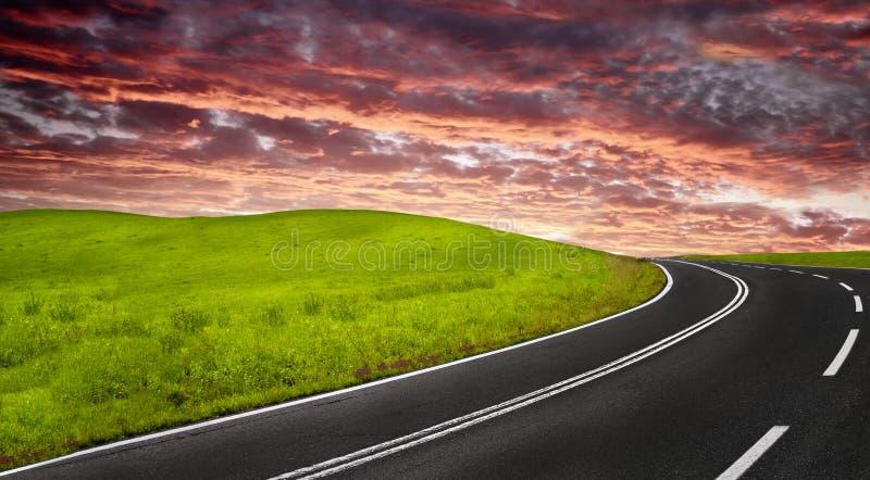 Camino en la puesta del sol imagen de archivo libre de regalías