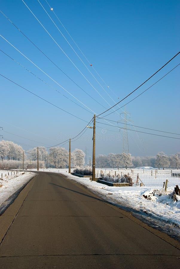 Camino en paisaje de los inviernos fotos de archivo libres de regalías