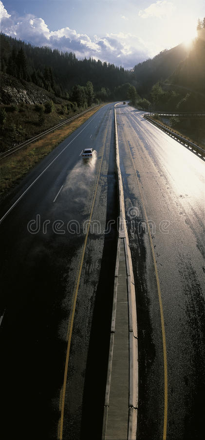 Camino mojado de la ruta 90, Idaho foto de archivo libre de regalías