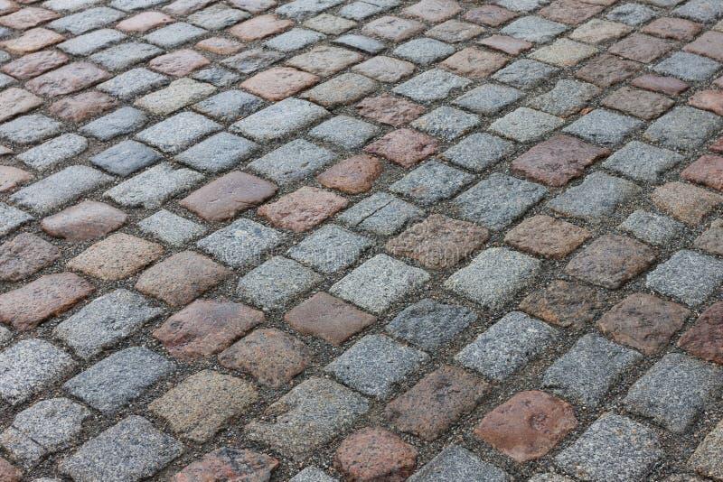 Camino pavimentado piedra vieja de la calle de la avenida imagen de archivo