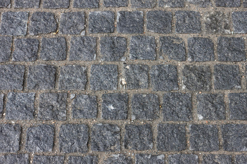 Camino pavimentado piedra vieja de la calle de la avenida imágenes de archivo libres de regalías