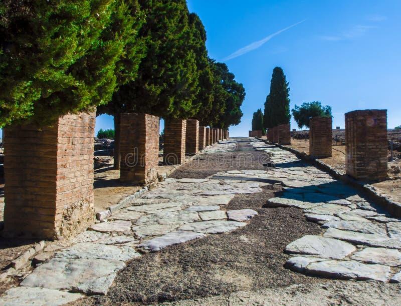 Camino romano antiguo en Italica fotos de archivo libres de regalías