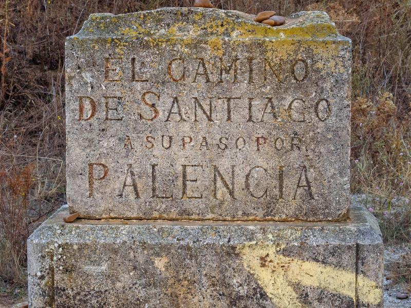 Camino waymark - San Nicolas del Real Camino. `The way of Santiago as it passes through Palencia` says the Camino waymark at the border of the Palencia and Leon royalty free stock photos