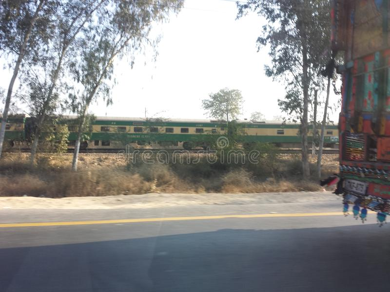 Camion, treno ed automobile fotografia stock