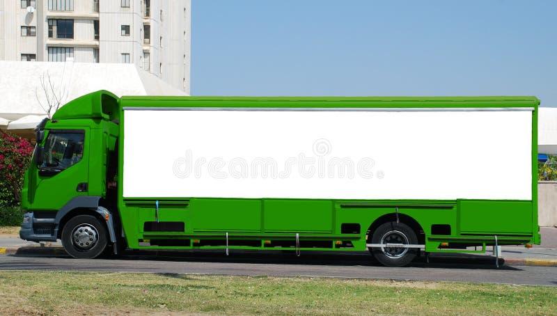 Camion vert avec le panneau blanc image stock