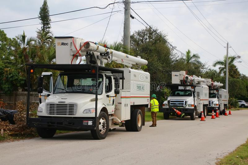 Camiones del ajuste del árbol después del huracán Irma foto de archivo libre de regalías