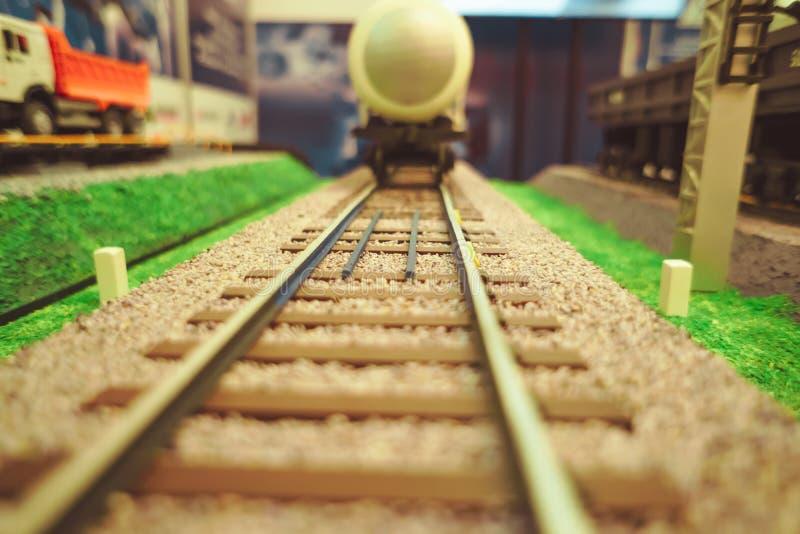 Camiones del juguete en un camino del juguete imagen de archivo libre de regalías
