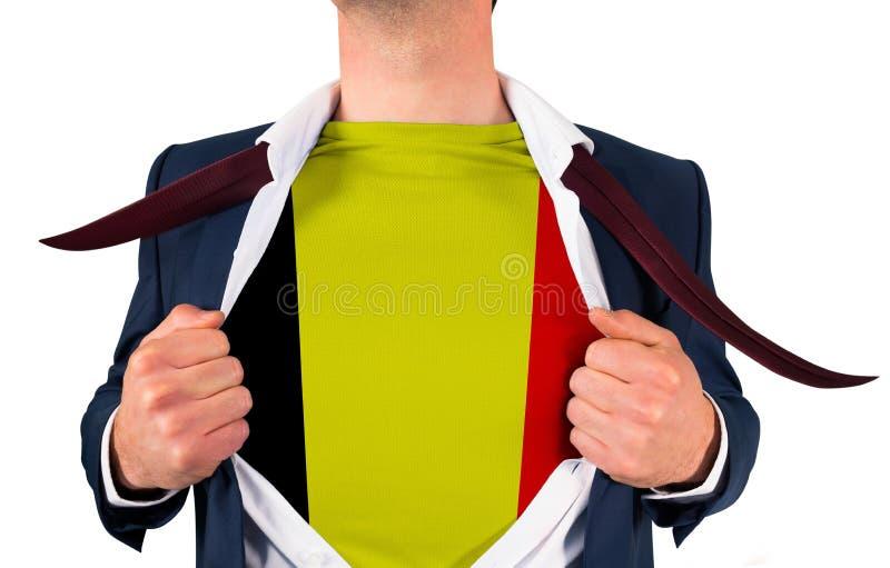 Camisa da abertura do homem de negócios para revelar a bandeira de Bélgica fotografia de stock