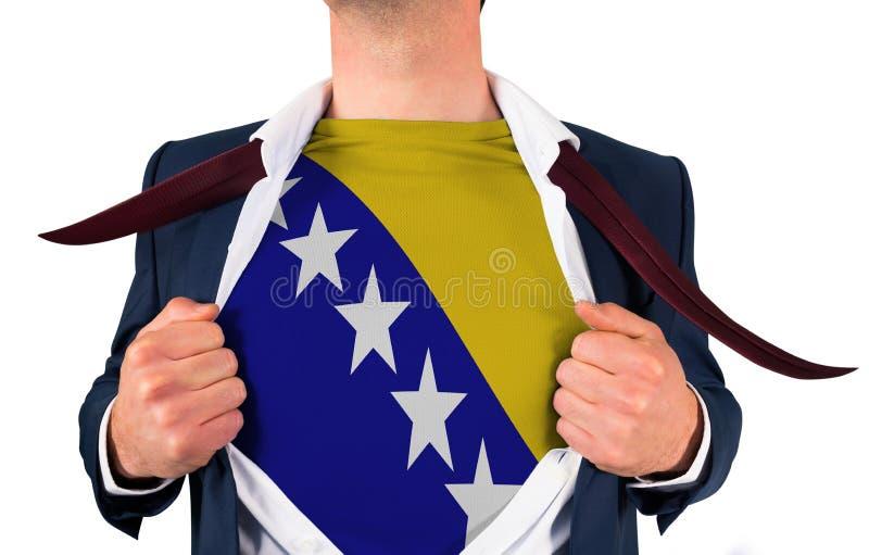 Camisa da abertura do homem de negócios para revelar a bandeira de Bósnia fotos de stock