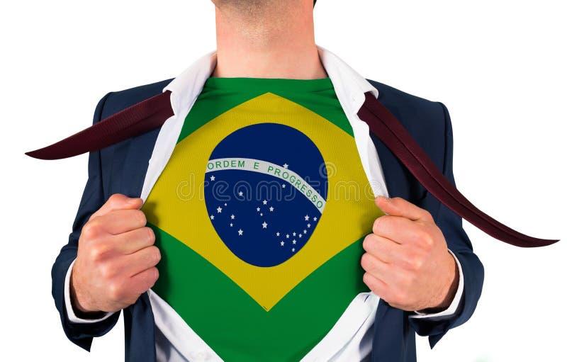 Camisa da abertura do homem de negócios para revelar a bandeira de Brasil imagens de stock
