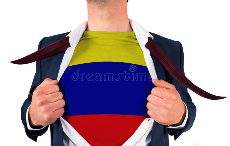 Camisa da abertura do homem de negócios para revelar a bandeira de Colômbia fotos de stock