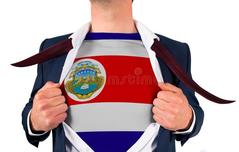 Camisa da abertura do homem de negócios para revelar a bandeira de Costa-Rica imagens de stock royalty free