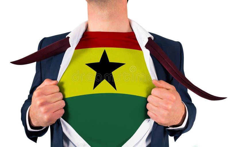 Camisa da abertura do homem de negócios para revelar a bandeira de ghana fotografia de stock royalty free