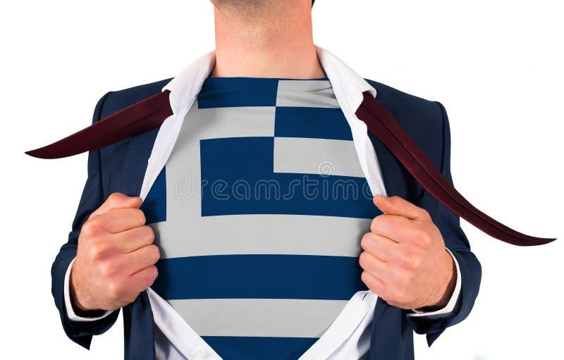 Camisa da abertura do homem de negócios para revelar a bandeira de greece foto de stock royalty free