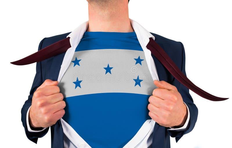 Camisa da abertura do homem de negócios para revelar a bandeira de honduras foto de stock royalty free