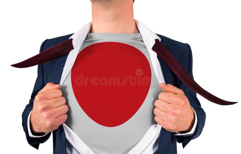 Camisa da abertura do homem de negócios para revelar a bandeira de japão imagem de stock royalty free