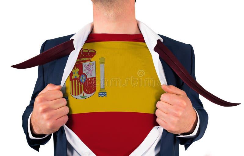 Camisa da abertura do homem de negócios para revelar a bandeira de spain foto de stock