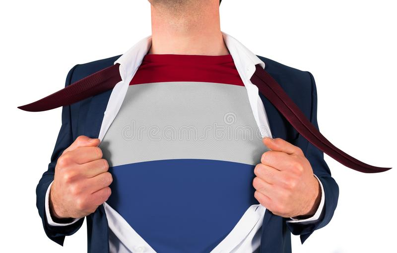 Camisa da abertura do homem de negócios para revelar a bandeira holandesa fotos de stock royalty free
