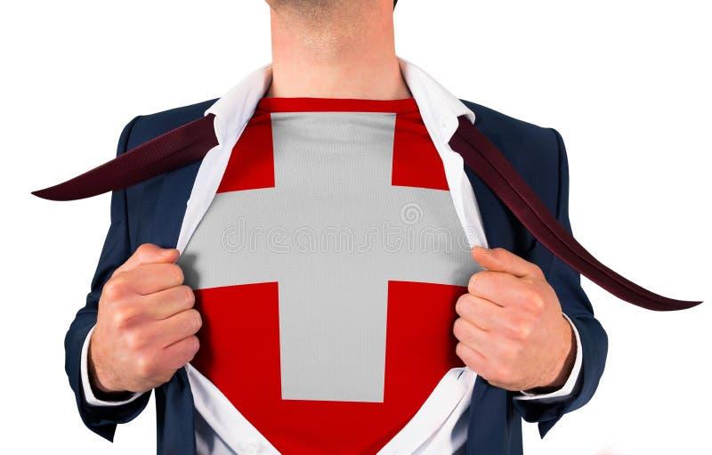 Camisa da abertura do homem de negócios para revelar a bandeira suíça fotos de stock royalty free