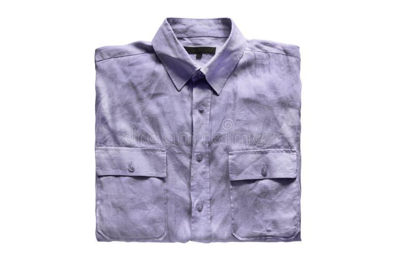 Camisa doblada aislada imagen de archivo