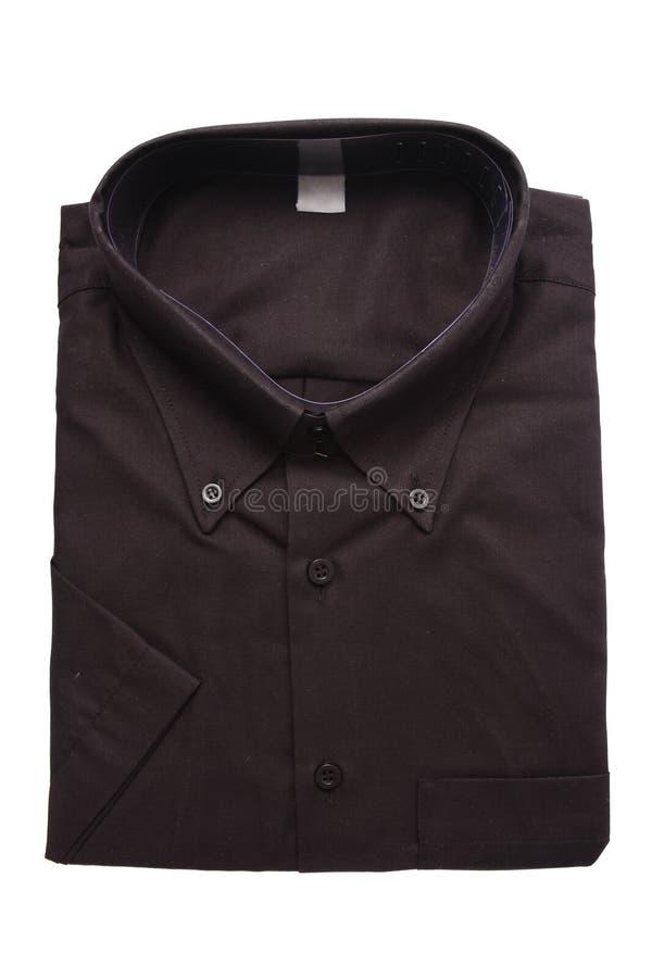 Camisa doblada negro foto de archivo