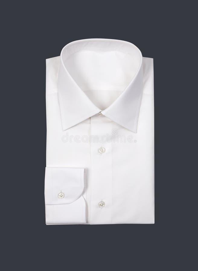 Camisa dobrada do homem branco imagem de stock