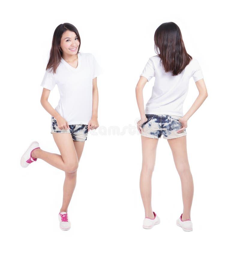 Camisa nova do branco do espaço em branco da mostra da menina da beleza fotografia de stock