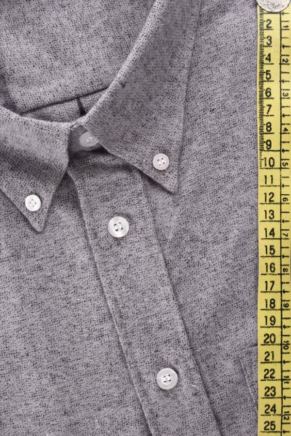 Camisa y cinta métrica fotografía de archivo