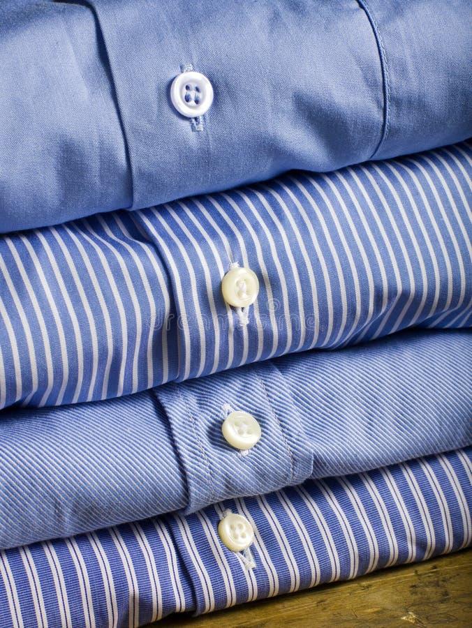 Camisas azuis foto de stock