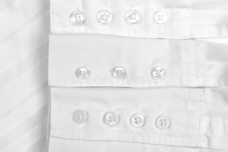 Camisas blancas de la manga para el botón de las mujeres fotografía de archivo