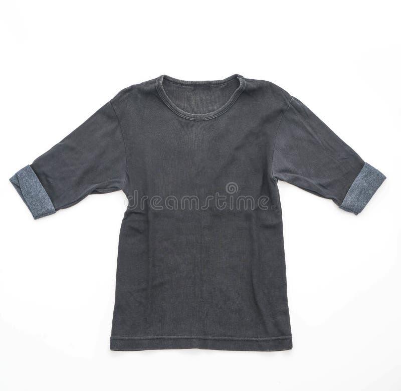 camiseta negra doblada en blanco fotos de archivo