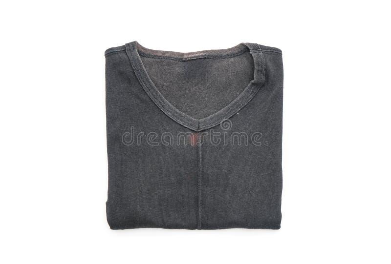 camiseta negra doblada en blanco fotografía de archivo libre de regalías