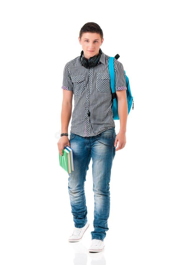 Camminata teenager dello studente del ragazzo fotografia stock libera da diritti