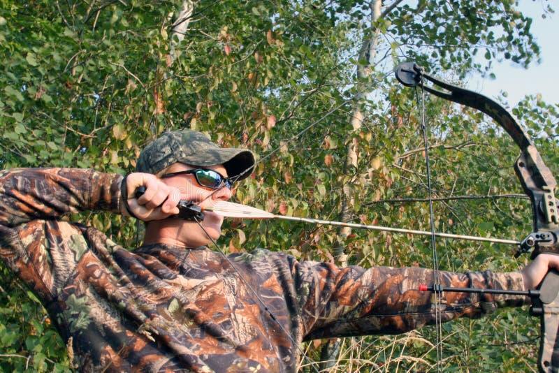 Cammo bow hunter royalty free stock photography