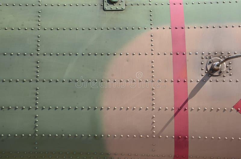 Cammuffamento militare dell'elicottero Cammuffamento del dettaglio degli ærei militari Vista circa la fusoliera con i colori dell immagine stock