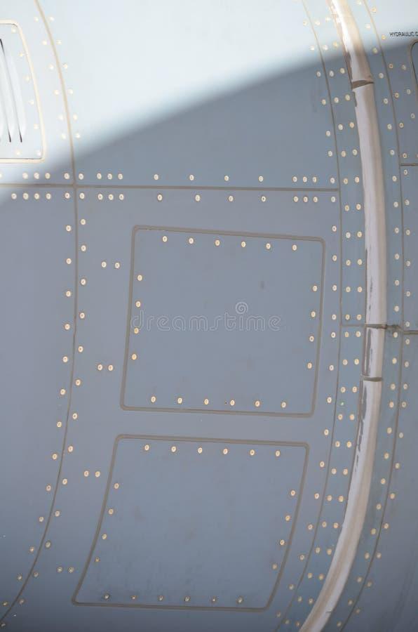 Cammuffamento militare dell'elicottero Cammuffamento del dettaglio degli ærei militari Vista circa la fusoliera con i colori dell fotografia stock