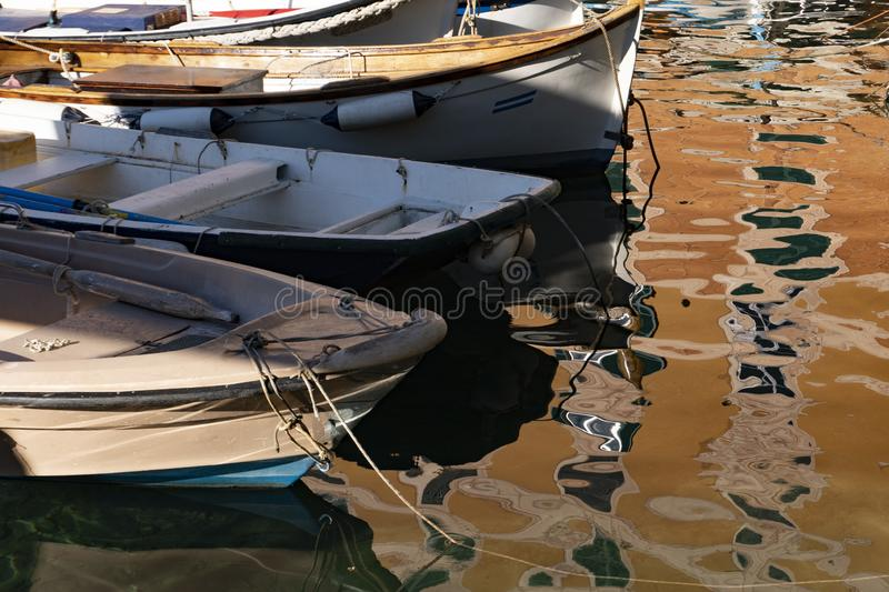 Camogli houses reflection in the harbor water sea stock photo