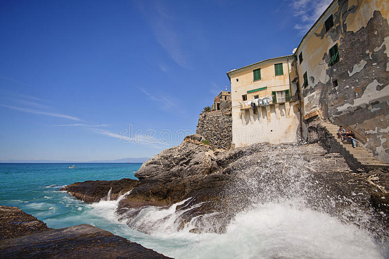 Camogli, Italy - spectacular view of the rocky coast and ancient royalty free stock image