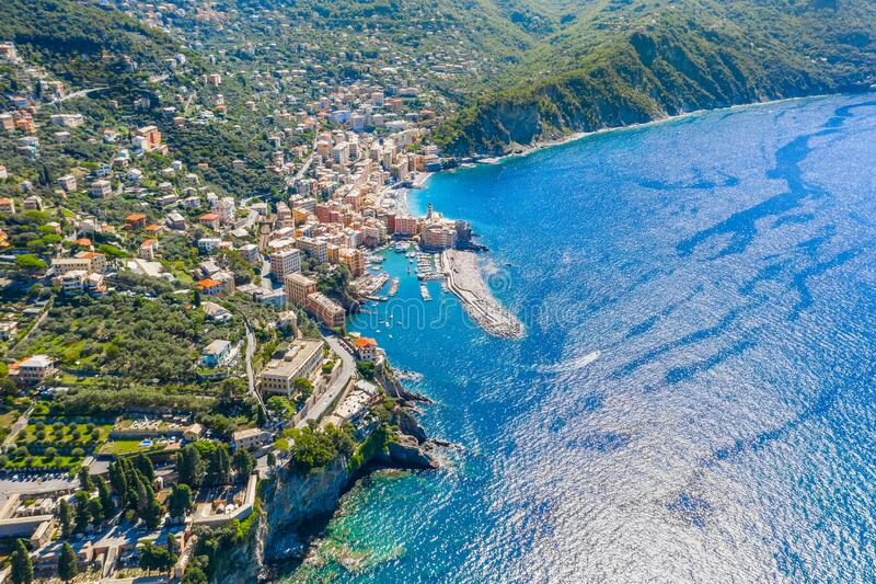 Camogli Marina aerial view. Boats and yachts moored in harbor with green water. A lot fo colorful buildings stock photos