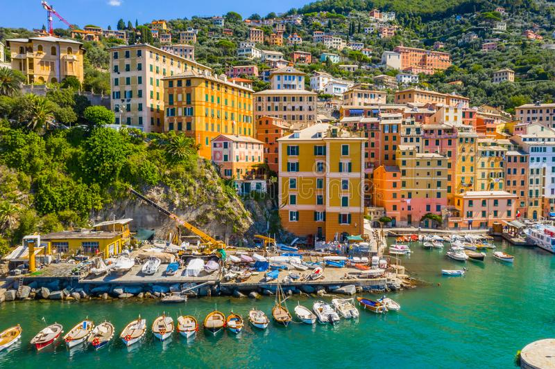 Camogli Marina aerial view. Boats and yachts moored in harbor with green water. A lot fo colorful buildings stock photo