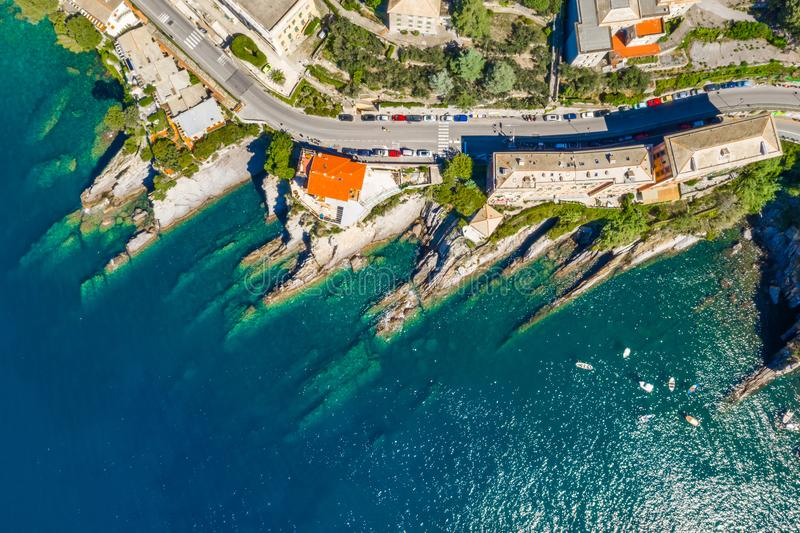 Camogli rocky coast aerial view. Boats and yachts moored near harbor with green water royalty free stock photography
