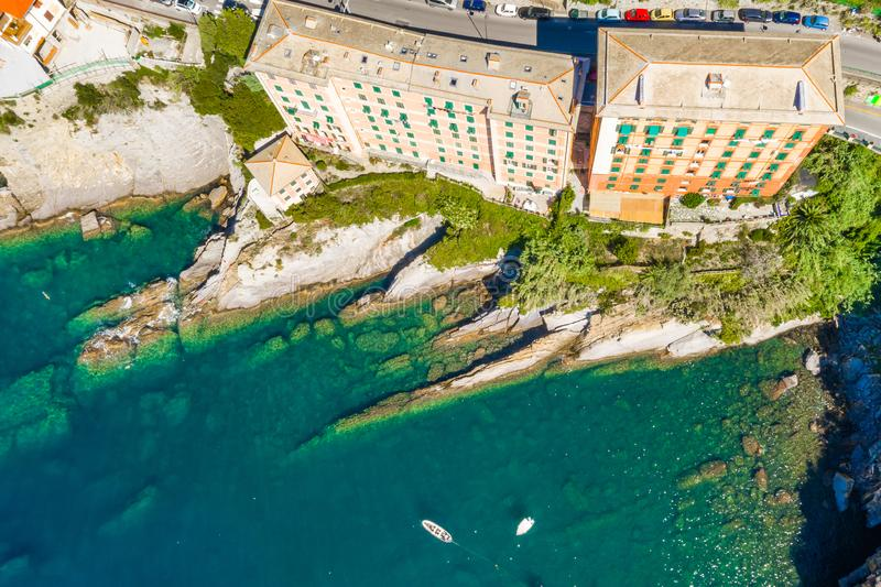 Camogli rocky coast aerial view. Boats and yachts moored near harbor with green water royalty free stock image