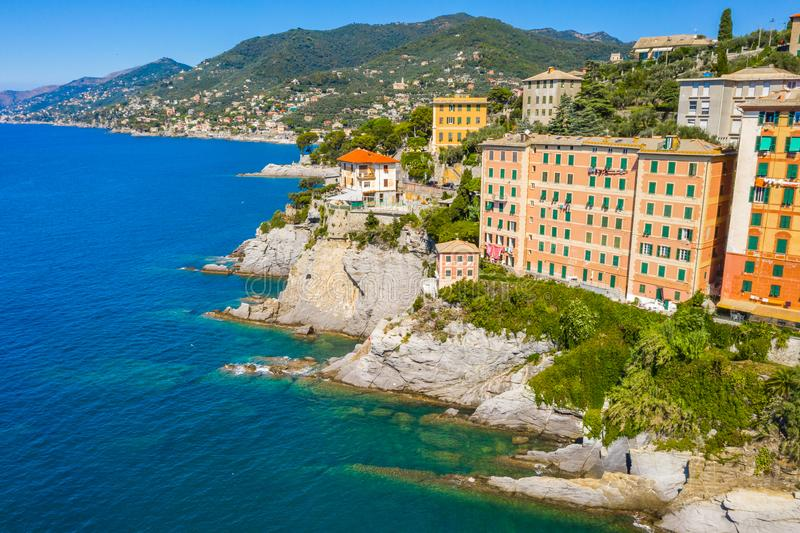 Camogli rocky coast aerial view. View from harbor with green water royalty free stock photos