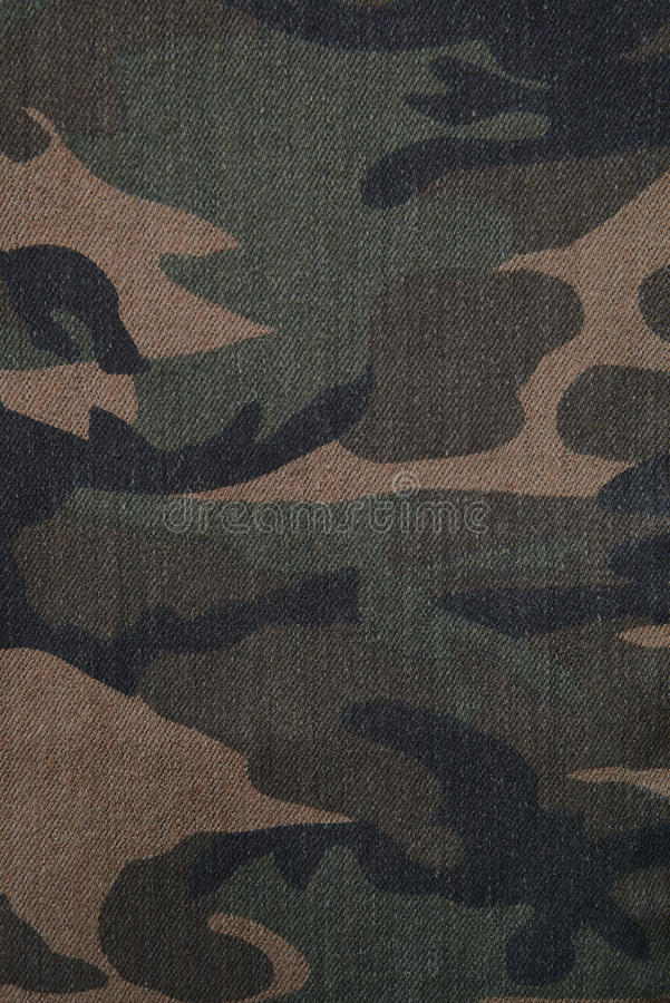 Camouflage brown and green denim military textile background vertical royalty free stock photos