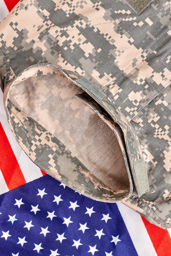 Camouflage clothes and us flag, close up. Top view stock photo