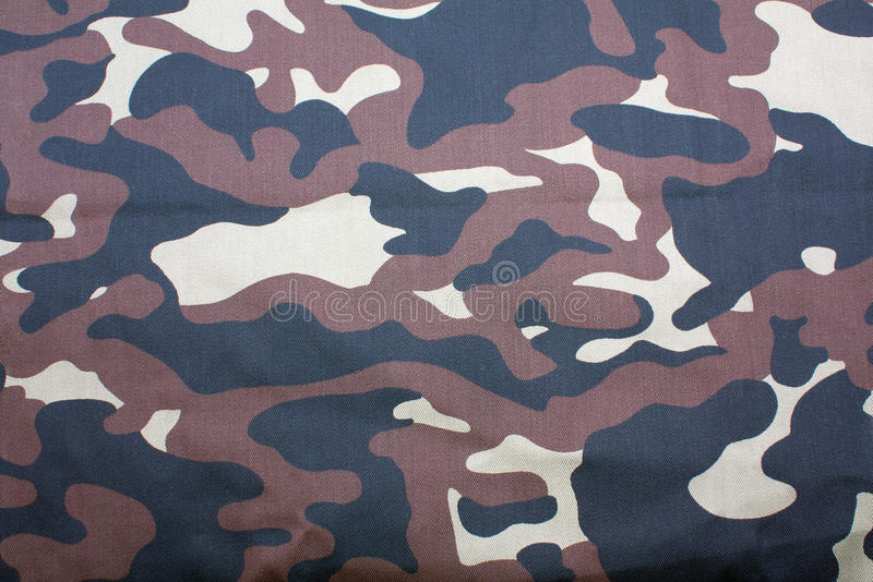 A camouflage fabric background stock image
