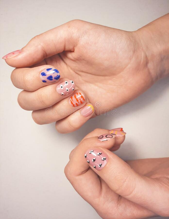 Free Camouflage Gel Nail Polish With Multi-colored Design And Different Patterns. Manicure Beige Color With Patterns. Stock Images - 214923174