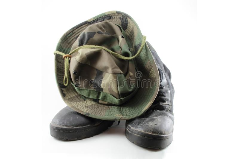 Camouflage hat and boots. royalty free stock image