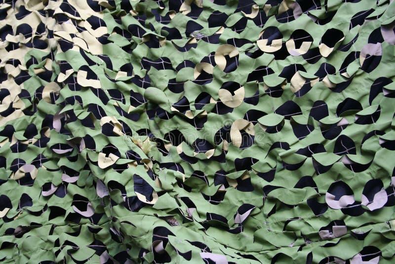 Camouflage netting stock image